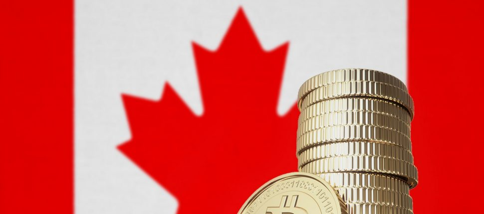 Stack of physical bitcoins with Canada flag in the background