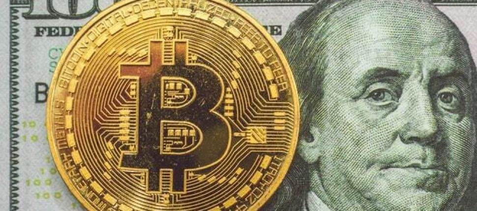 bitcoin overlaid on top of USD 100 dollar bill