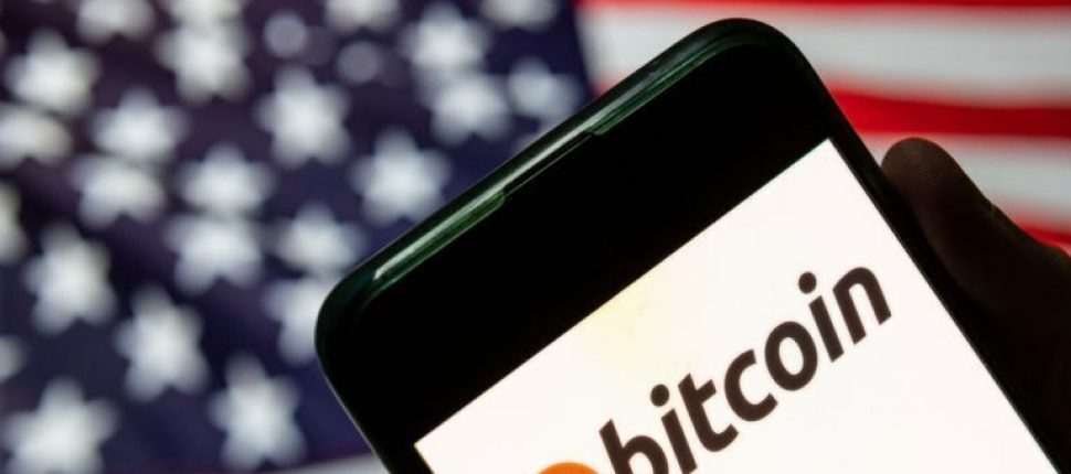 Bitcoin logo in front of a USA flag